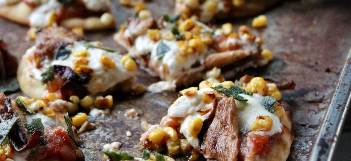 Spicy Peach Flatbread with Toasted Corn, Sautéed Mushrooms, and Burrata Cheese
