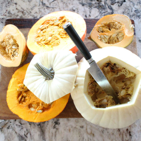 Open the pumpkins and squashes with the knife.